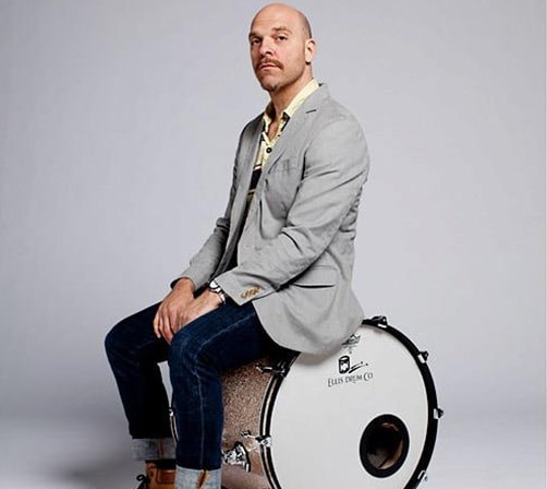 Dave King sitting on drum